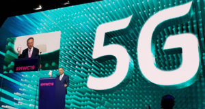 KT Chairman and CEO Hwang Chang-Gyu displays a 5G smartphone during his keynote speech at MWC 2019 in February.